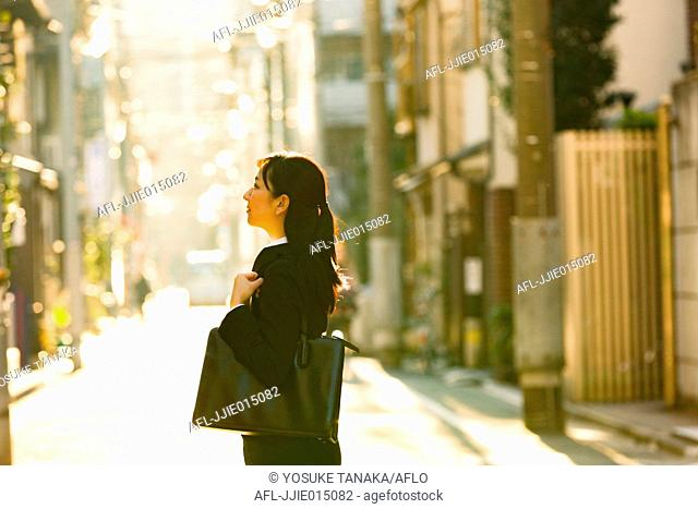 Japanese young businesswoman downtown Tokyo