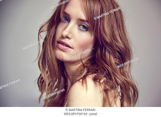 Portrait of lascivious redheaded woman