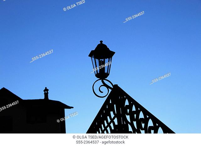 Decorative street light and a roof of house in twilight. Ordino, Andorra, Europe