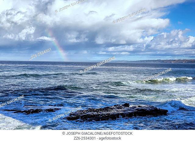 Ocean, clouds, rainbow, and waves. View from La Jolla, CA, USA