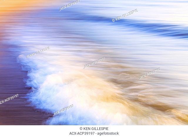 Motion blurred waves crashing on Lake Winnipeg. Gimli, Manitoba, Canada