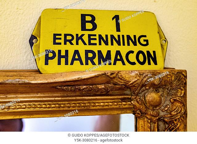 Tilburg, Netherlands. Vintage enamel schield, licencing a shop to sell low grade pharmaceuticals and home remedies. These kind of shield have become collectors...