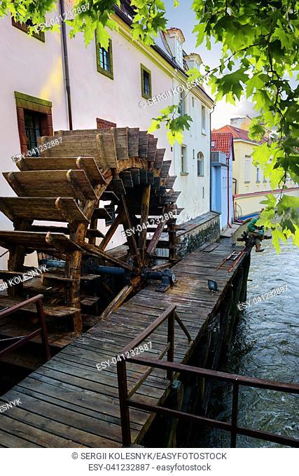 Prague wooden water mill near maple tree