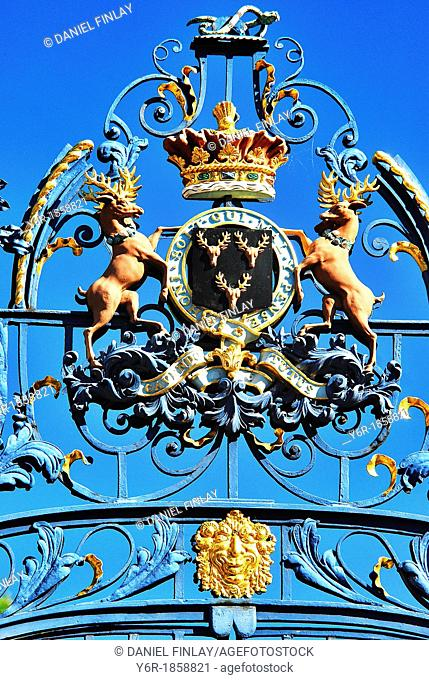 Coat-of-arms on gate to Green Park, Piccadilly, London, UK, on a sunny Summer day