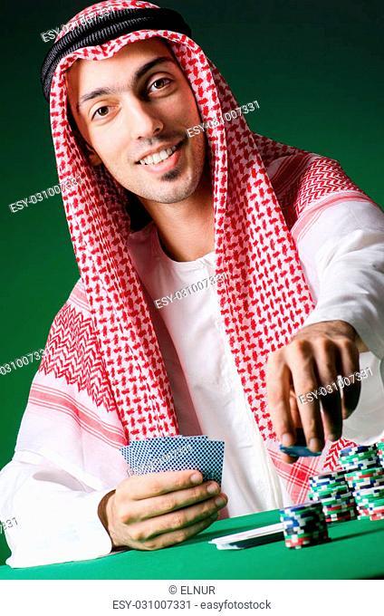 Arab man playing in the casino