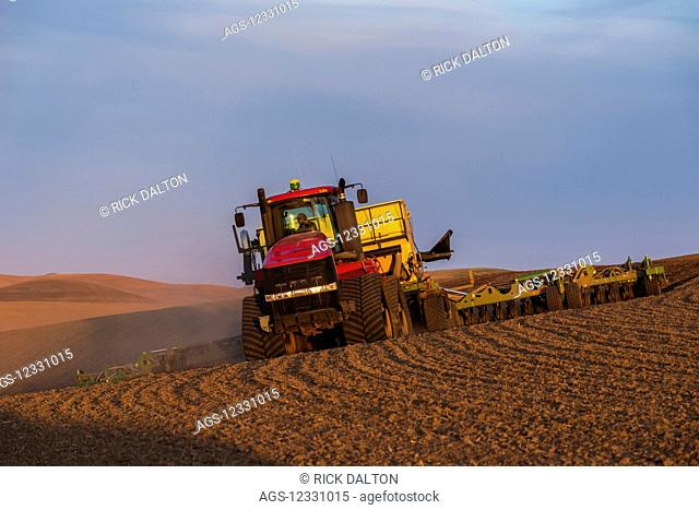 Quadtrac Tractor Seeding Garbanzo Beans In The Palouse Region Of Eastern Washington; Washington, United States Of America