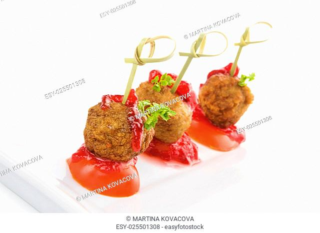 Delicious meatballs canape isolated on white background. Fresh modern image language. Culinary arts