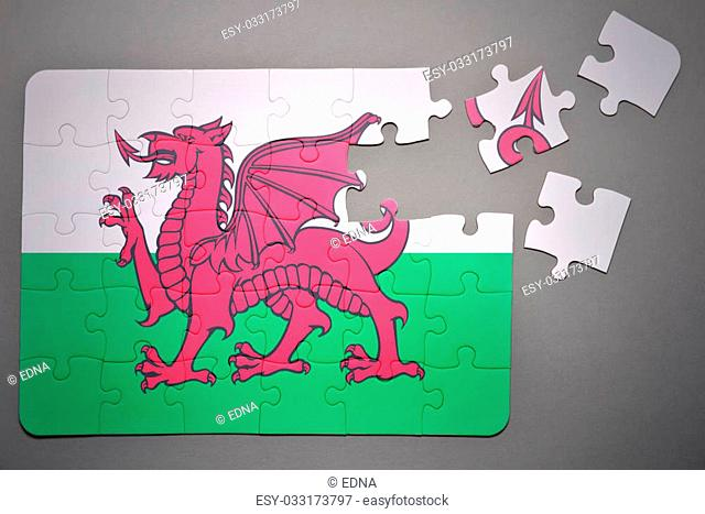 broken puzzle with the national flag of wales on a gray background