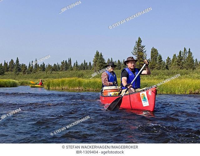 Two men in canoe, paddling, canoeing, Caribou Lakes, Kayak behind, upper Liard River, Yukon Territory, Canada