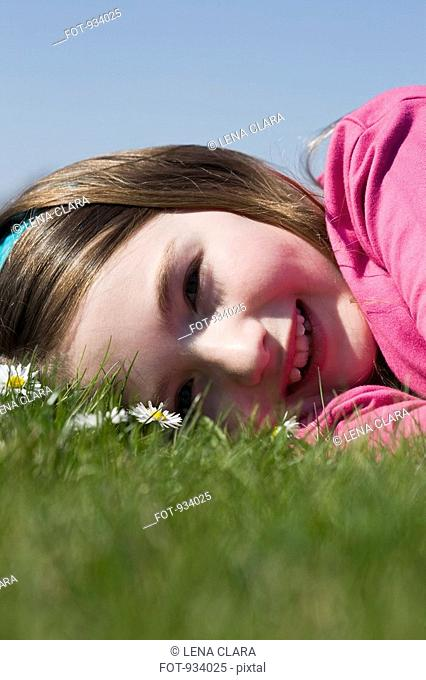 Detail of a girl lying down on grass