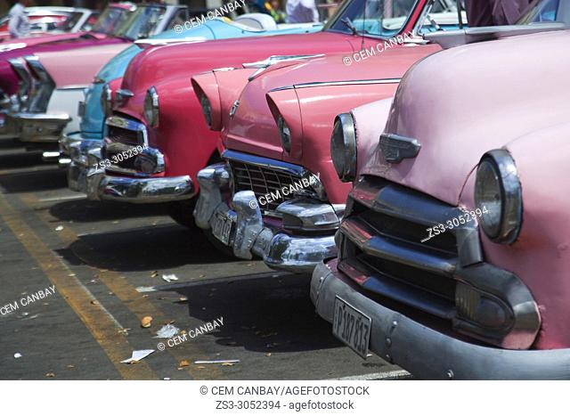 Various vintage American cars at the parking lot in Center Havana, La Habana, Cuba, Central America