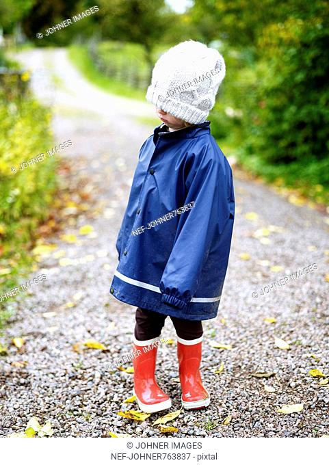 A disappointed girl in a blue raincoat, Sweden