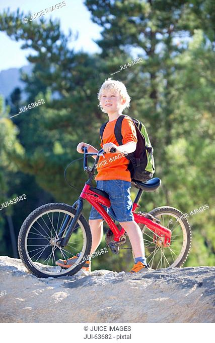 Portrait of boy on mountain bike