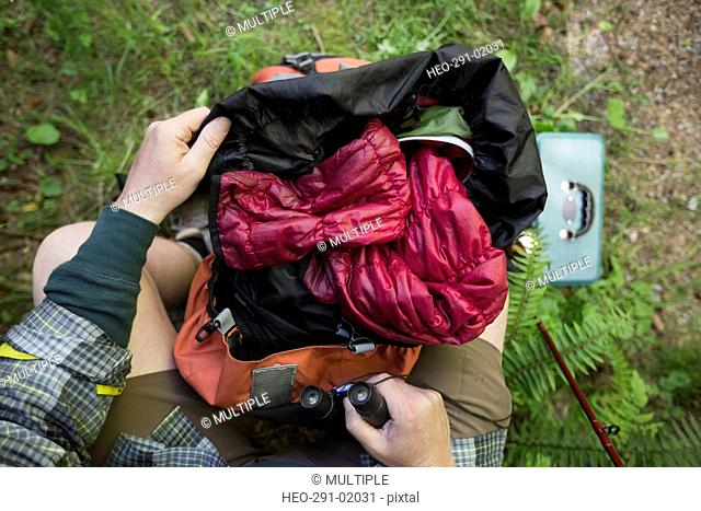 Personal perspective man opening hiking backpack