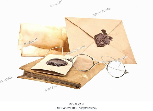 old glasses and old paper isolated on white background