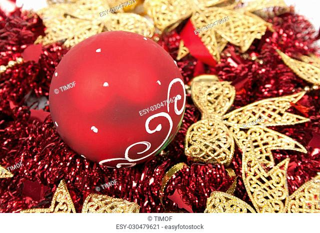 Red balls on red tinsels and gold bows like a background for greeting card