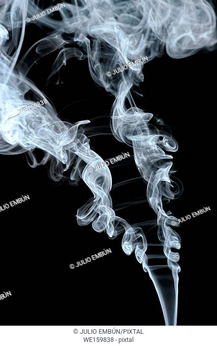 abstract shapes formed by scrolls of incense smoke