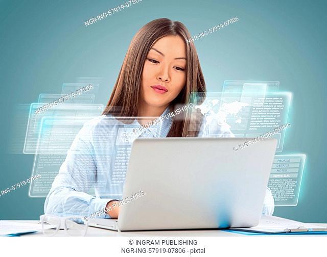 Attractive businesswoman against hightech background