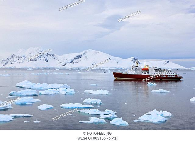 South Atlantic Ocean, Antarctica, Antarctic Peninsula, Gerlache Strait, Paradise Bay, Polar star icebreaker cruise ship between ice on sea
