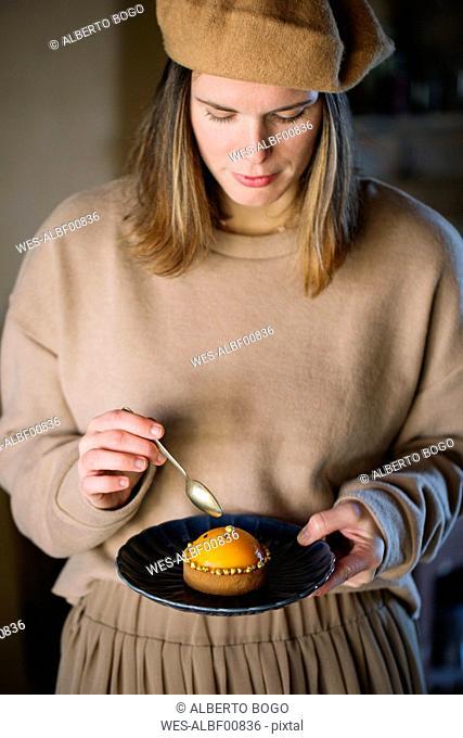 Woman eating peach tarlet