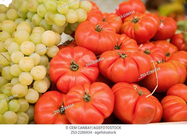 Tomatoes and grapes at the Mercado de Nuestra Senora de Africa market, Santa Cruz, Tenerife, Canary Islands, Spain, Europe