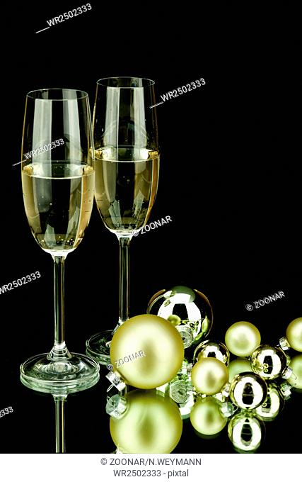christmas decoration and champagne on black