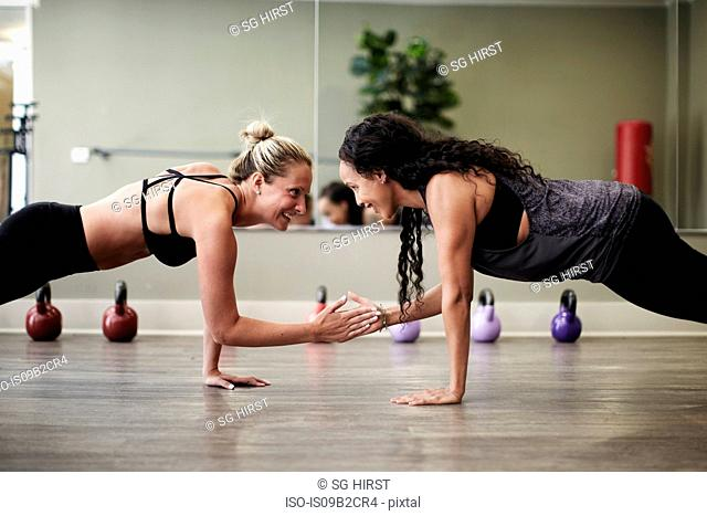 Women doing plank in gym