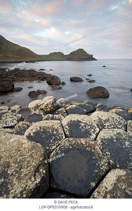 Northern Ireland, County Antrim, Giants Causeway, Interlocking basalt columns of the Giants Causeway, named as the fourth natural wonder in the UK