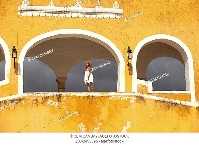 Women at the stairs of the Monastery, Convent Of San Antonio De Padua, Izamal, Yucatan, Yucatan Province, Mexico, Central America