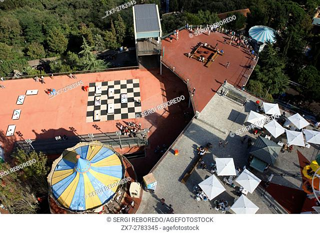 The Tibidabo theme park, Barcelona, Spain. Tibidabo is a mountain overlooking Barcelona, Catalonia, Spain. At 512 meters it is the tallest mountain in the Serra...