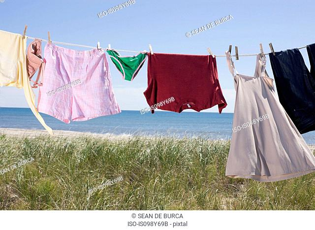 Laundry drying on clothes line by sea