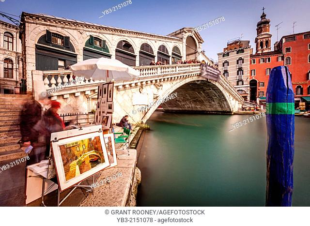Local Artist Selling Paintings By The Rialto Bridge, Venice, Italy