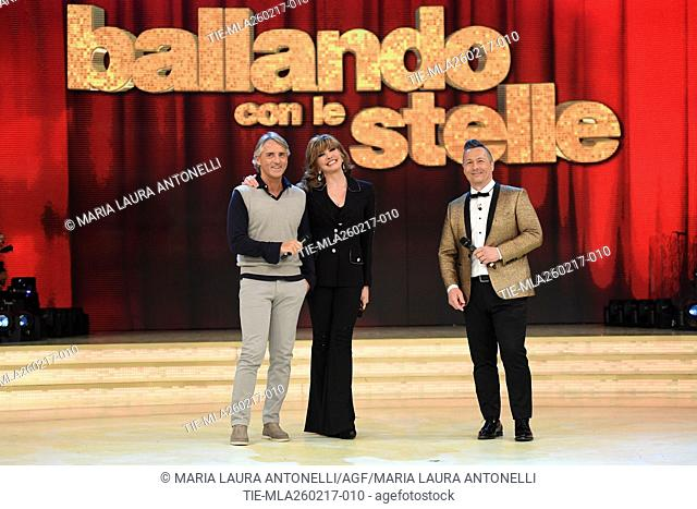 The soccer coach Roberto Mancini with the host Milly Carlucci and Paolo Belli at tv show Ballando con le stelle, Rome, ITALY-25-02-2017