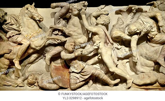Greek relief sculptures of a battle on Alexander The Great ( Alexander III of Macedon )4th Cent BC. Sarcophagus calved from Pentelic Marble from the Royal...