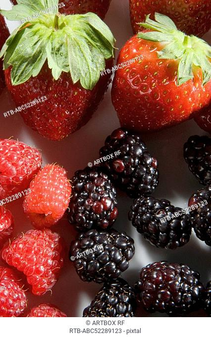 Close-up of strawberries with blackberries