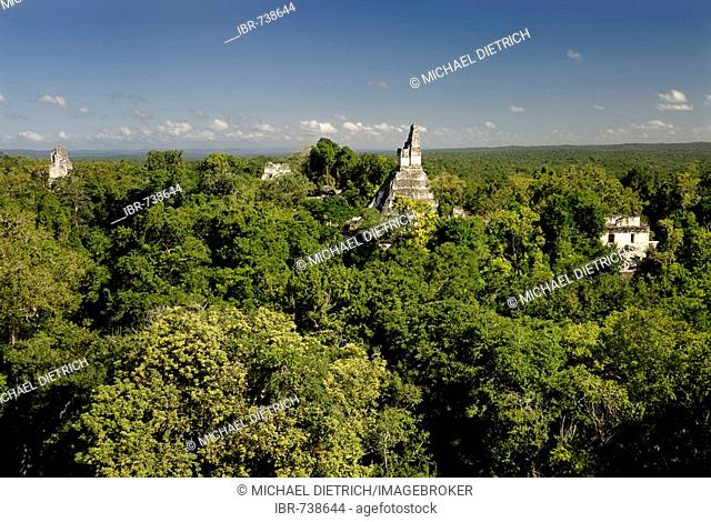Mayan ruins of Tikal - View from Temple III to Temple I, Temple of the Giant Jaguar, and II, Yucatan, Guatemala, Central America