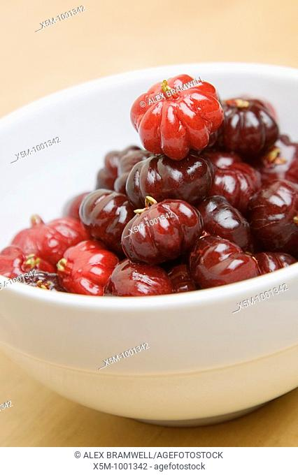 Pitanga fruit of Surinam Cherries, from the Eugenia uniflora tree  Native to Northern South America biut common across the tropical and subtropical world...