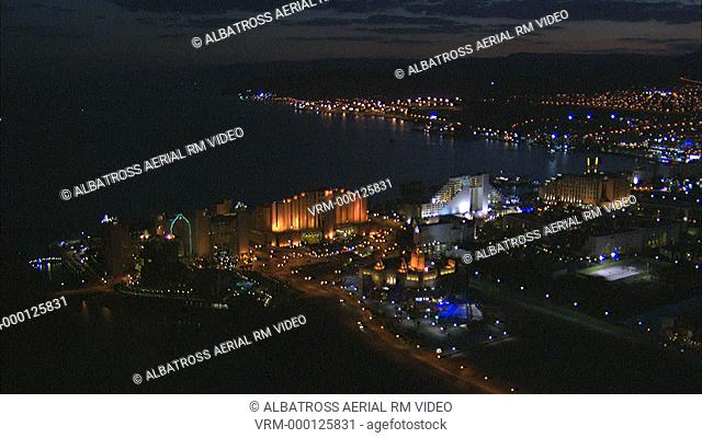 Aerial HD shot of hotel resorts in the city of Eilat on Eilat Bay, Red Sea, night