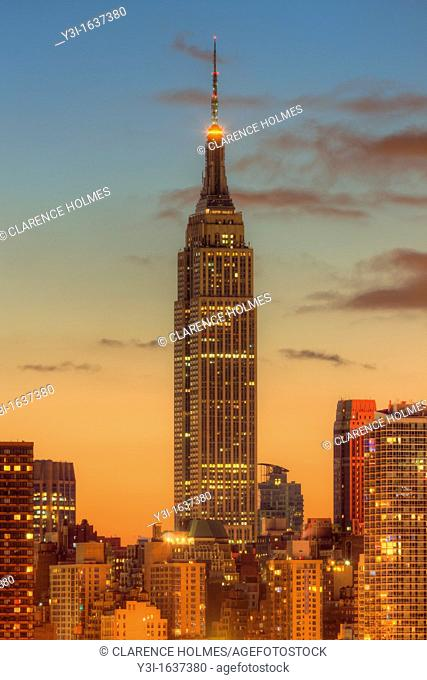 The Empire State Building during morning twilight as viewed over the Hudson River looking east from New Jersey  The eastern sky and clouds were accented with...