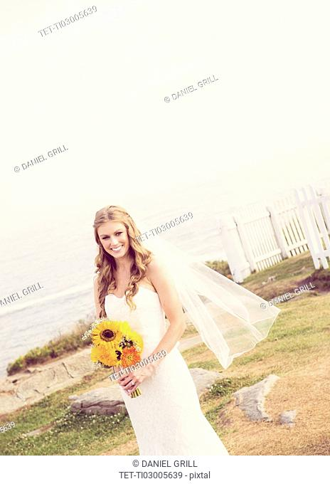 Portrait of bride holding sunflower bouquet