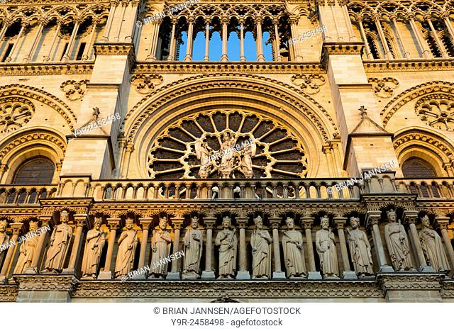 Setting sunlight on the front facade of Cathedral Notre Dame, Paris, France