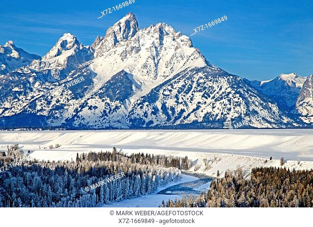 Tetons, morning light on The Teton Range and Grand Teton in winter above the Snake River at Grand Teton National Park in northern Wyoming