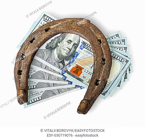 Old rusty horseshoe and money isolated on white background