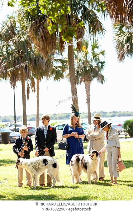 A family gathers in White Point gardens to take part in the annual Hat Ladies Easter promenade on April 7, 2012 in Charleston, South Carolina