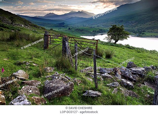 Mount Snowdon from Capel Curig. According to Welsh tradition, King Arthur met his death in a skirmish on Bwlch y Saetheau Pass of the Arrows and his knights lie...