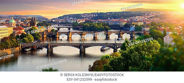 Overview of old Prague with Charles bridge at sunset