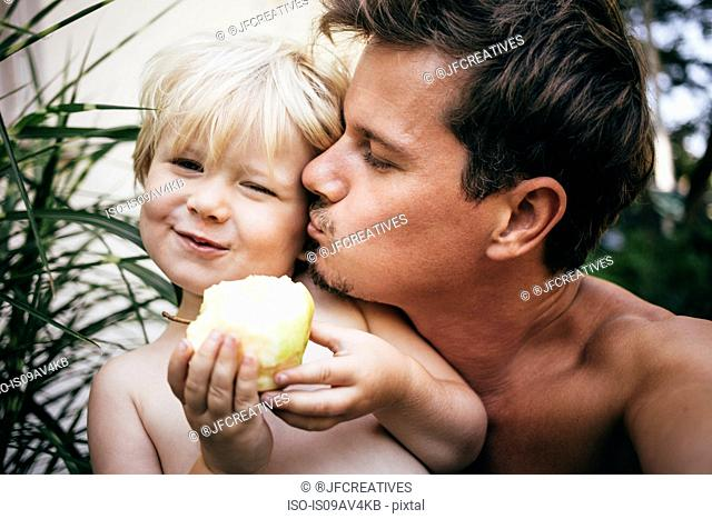 Head and shoulders of father kissing son on cheek, Bludenz, Vorarlberg, Austria