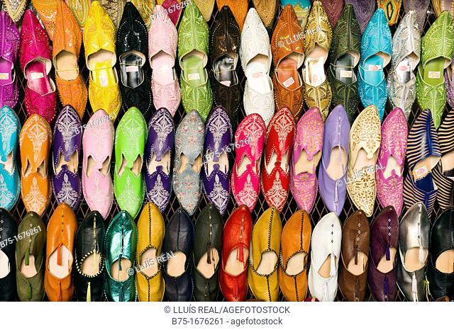 babuchas artesanas de colores en la medina de marrakech, marruecos, craft slippers color in the medina of Marrakech, Morocco