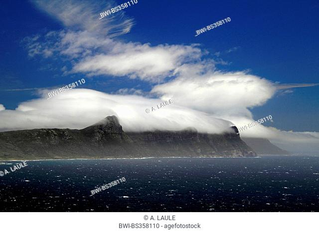 clouds cover the mountains at the coast, South Africa, Western Cape, Cape of Good Hope National Park