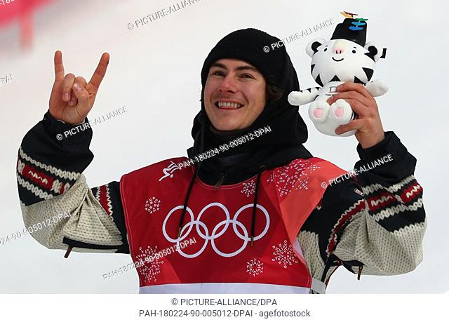 Gold medallist Sebastien Toutant from Canada celebrates his victory during the Snowboard Big Air finals in Pyeongchang, South Korea, 24 February 2018